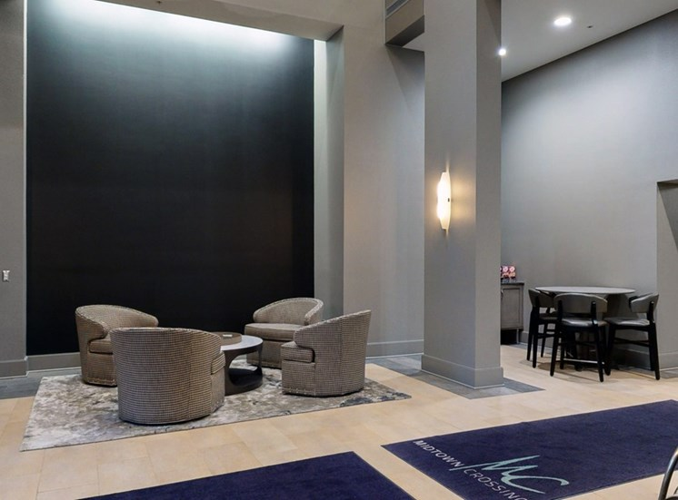 Grab a book and relax in the modern lobby at Midtown Crossing Apartments in Omaha.