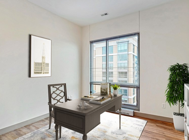 Bright and spacious bedroom that could be used as home office with floor-to-ceiling windows a 2 bedroom penthouse floor plan Midtown Crossing Apartments Omaha