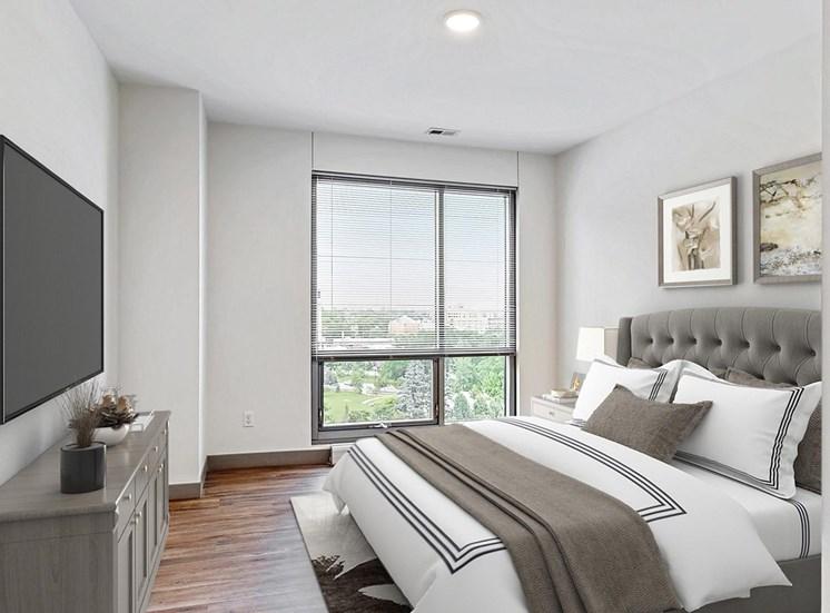 Spacious bedroom with floor-to-ceiling windows a 2 bedroom penthouse floor plan Midtown Crossing Apartments Omaha