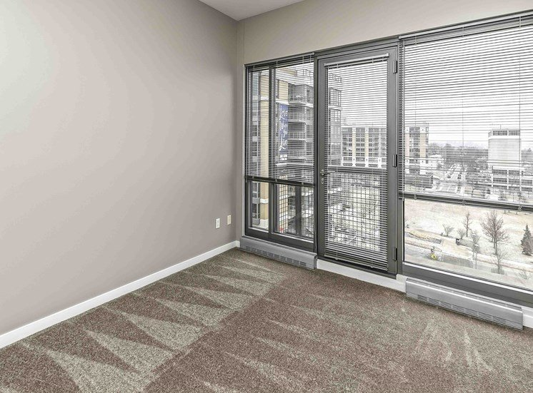 Bright Carpeted Living Room at Midtown Crossing Apartments, Omaha, NE, 68131