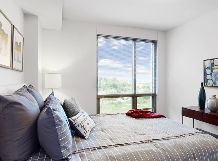 Bright and spacious bedroom with floor-to-ceiling windows a 1 bedroom floor plan Midtown Crossing Apartments Omaha