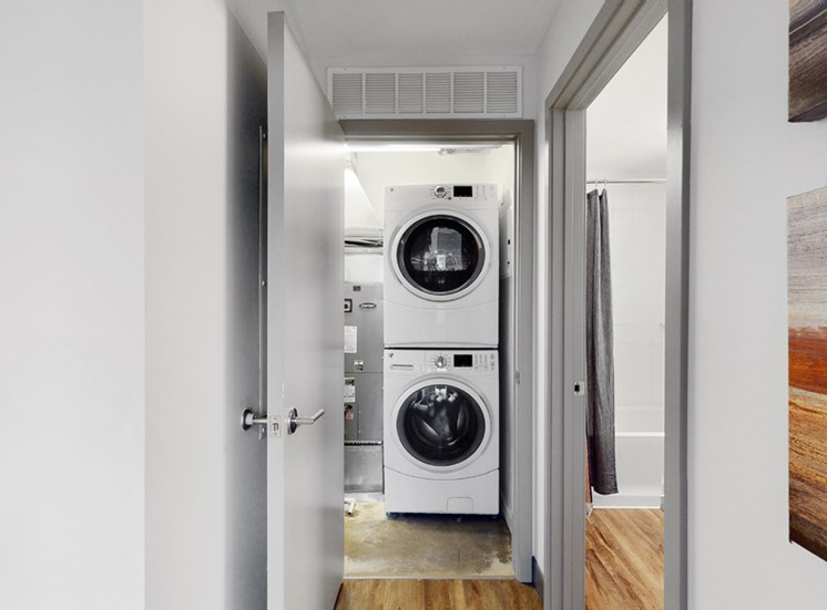 Full-size, front load, stacked washer and dryer is included in every floor plan at Midtown Crossing Apartments Omaha