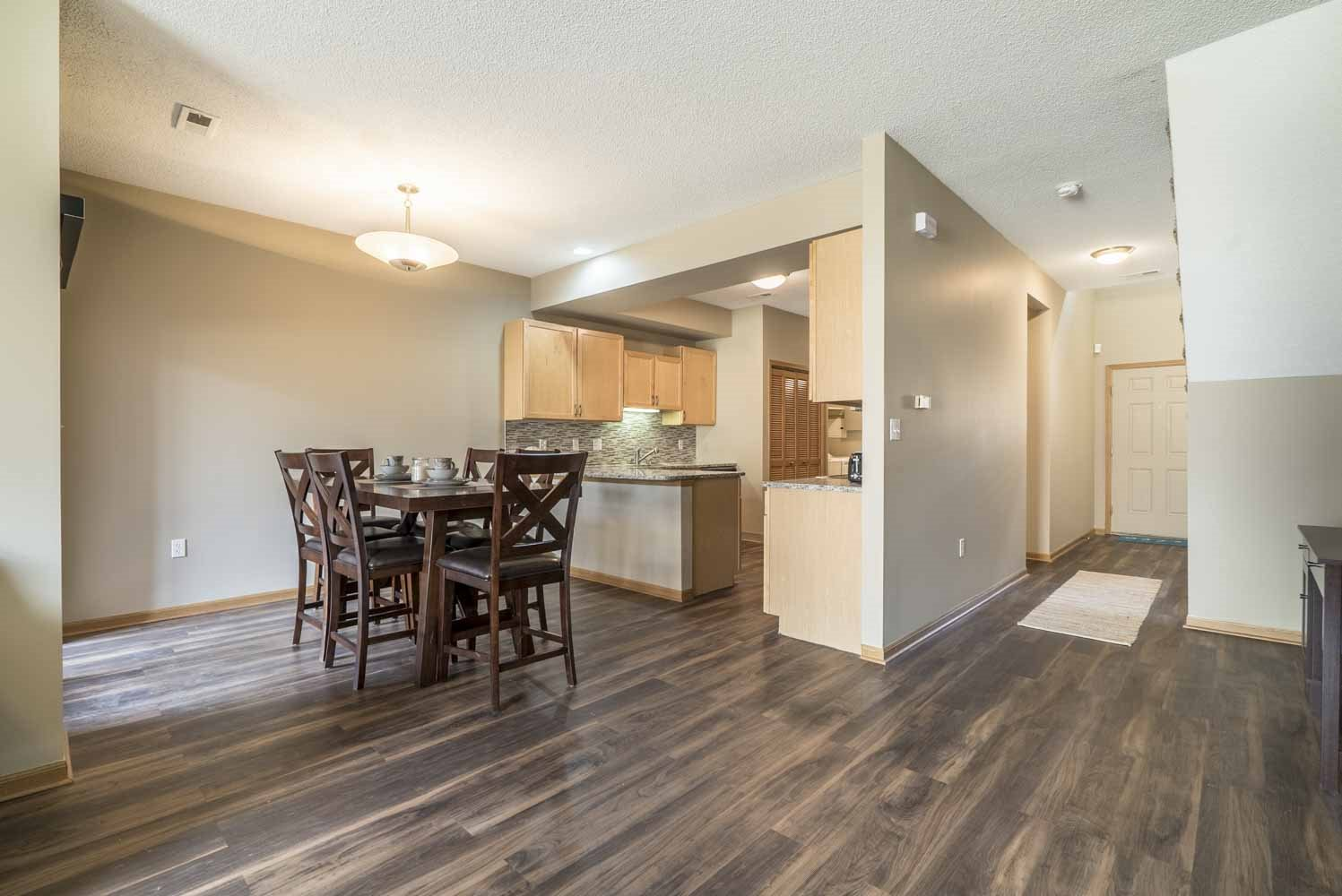 View of kitchen and dining room at Southwind Villas in southwest Omaha in La Vista, NE, 68128