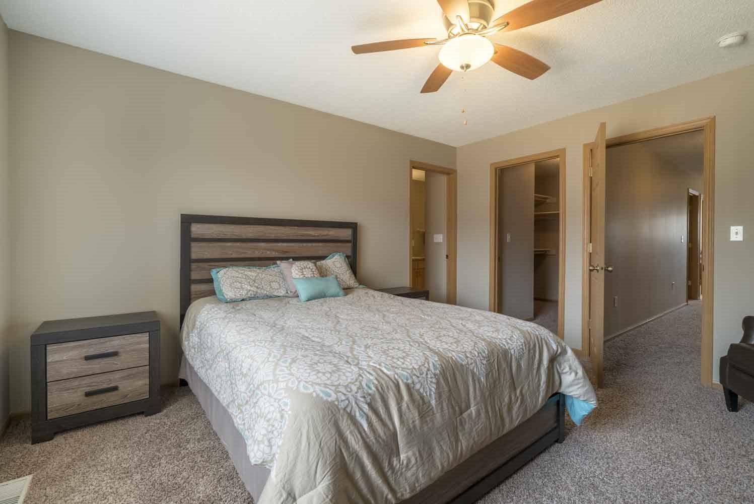Master bedroom with walk-in closet and master bath at Southwind Villas in southwest Omaha in La Vista, NE, 68128
