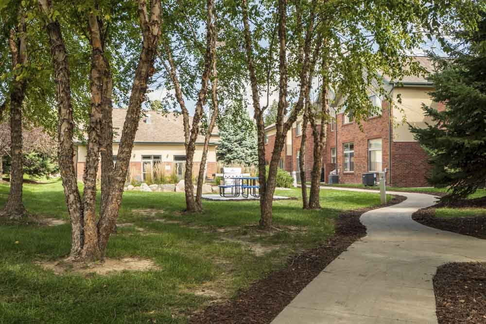 Scenic courtyard with mature trees and walking path  at Southwind Villas in southwest Omaha in La Vista, NE, 68128