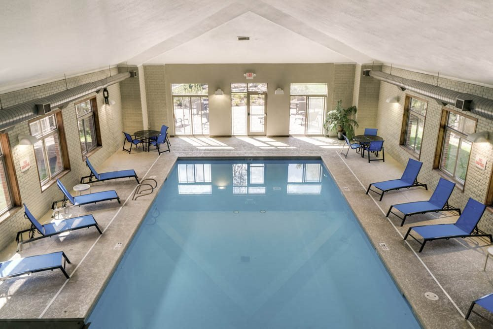 Indoor swimming pool with poolside chairs at Southwind Villas in southwest Omaha in La Vista, NE, 68128