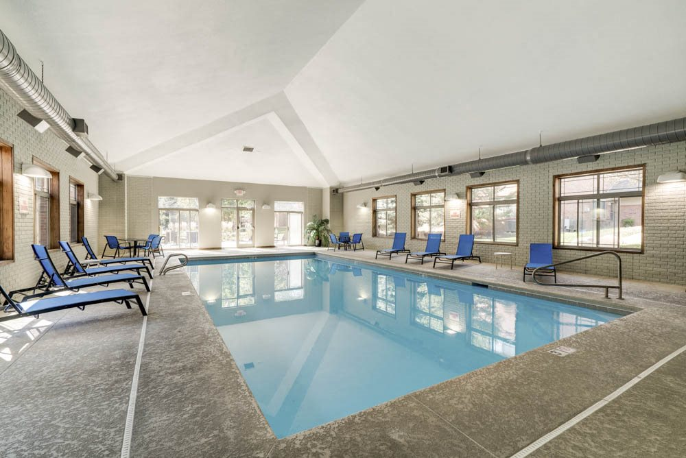 Indoor swimming pool with lounge chairs at Southwind Villas in southwest Omaha in La Vista, NE, 68128
