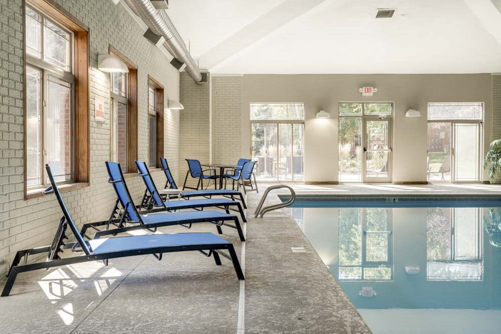 Lounge chairs next to indoor swimming pool at Southwind Villas in southwest Omaha in La Vista, NE, 68128