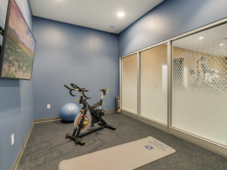 Private yoga and cycling studio at The Flats at Shadow Creek new luxury apartments in east Lincoln NE 68520