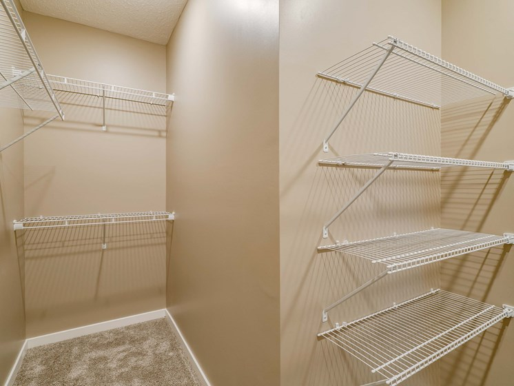 Walk in closet in master bedroom at The Flats at Shadow Creek new luxury apartments in east Lincoln NE 68520
