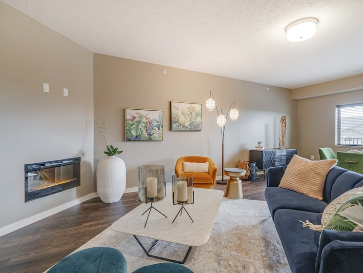 Spacious living room with modern fireplace at The Flats at Shadow Creek new luxury apartments in east Lincoln NE 68520