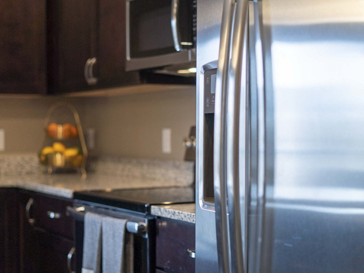 Spacious kitchens with granite countertops at The Flats at Shadow Creek new luxury apartments in east Lincoln NE 68520