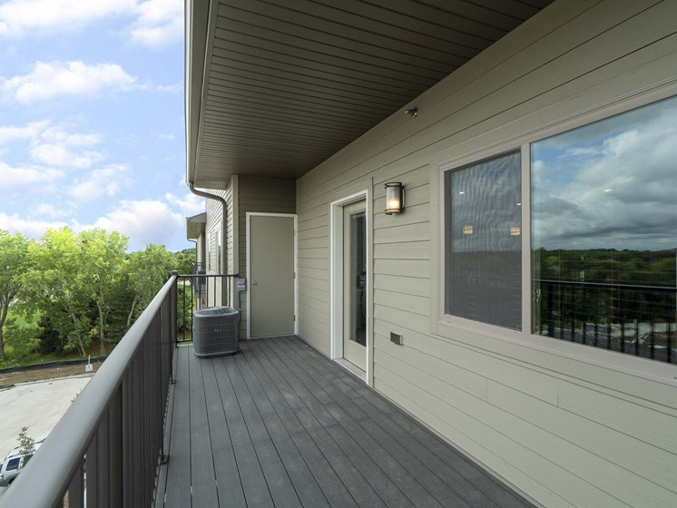 Spacious balcony and patio with beautiful views at The Flats at Shadow Creek new luxury apartments in east Lincoln NE 68520