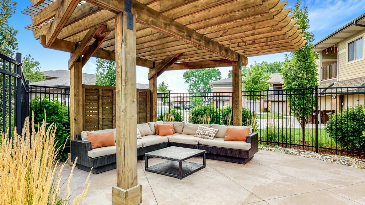 Relax poolside in the spacious pergola at The Villas at Wilderness Ridge luxury apartments in southwest Lincoln NE 68512
