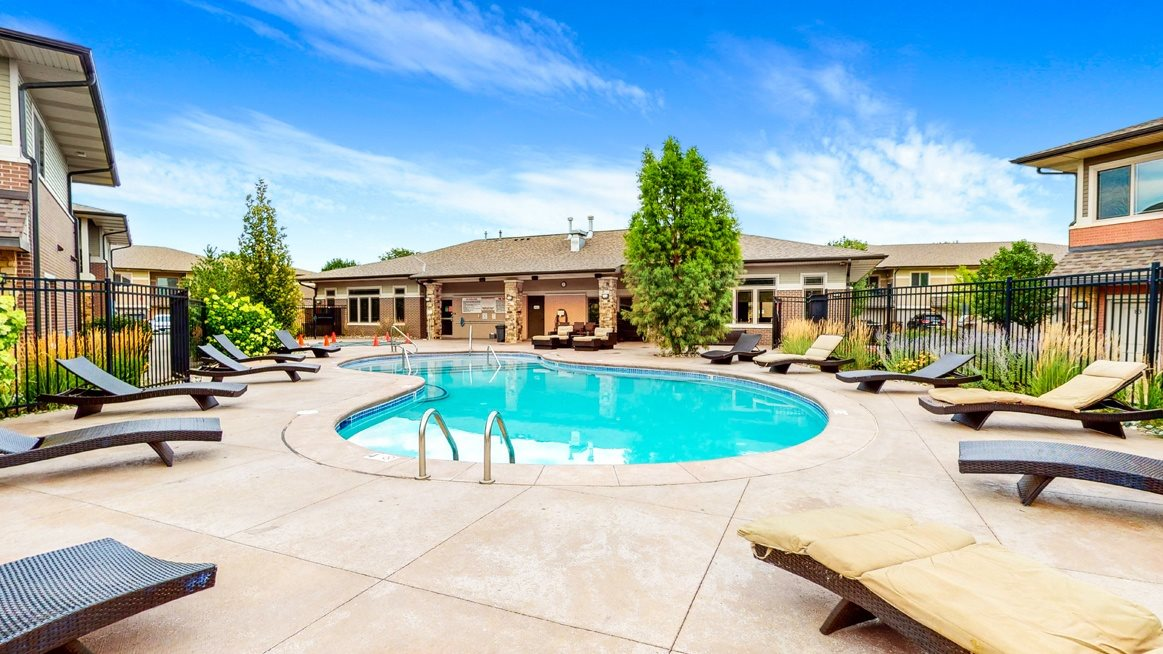 Relax by the sparkling pool and hot tub at The Villas at Wilderness Ridge in southwest Lincoln NE 68512