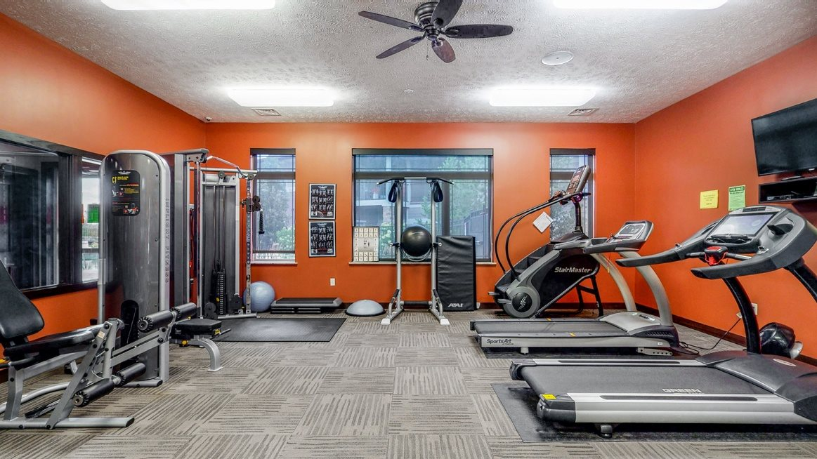 Expansive fitness room with modern equipment at The Villas at Wilderness Ridge luxury apartments in southwest Lincoln NE 68512