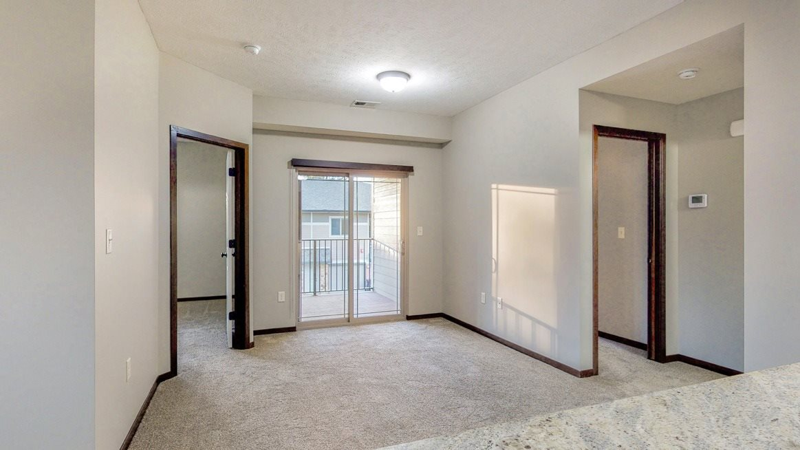 The kitchen overlooks the living area and private balcony at The Villas at Wilderness Ridge in southwest Lincoln NE 68512