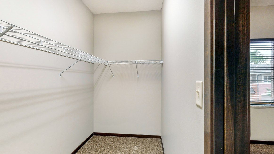 Walk in closet in the Ash 2 bedroom at The Villas at Wilderness Ridge luxury apartments in southwest Lincoln NE 68512