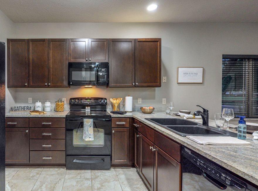 You'll love the abundant storage in the kitchen in this Cedar floor plan at The Villas at Wilderness Ridge