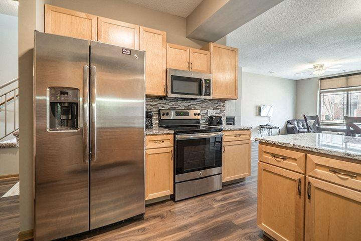 Upgraded unit with side-by-side stainless steel fridge and appliances at Southwind Villas townhomes in La Vista, NE, 68128