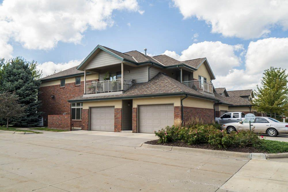 View of villas with attached garages and balconies at Southwind Villas in southwest Omaha in La Vista, NE, 68128