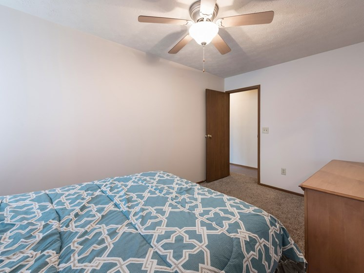 Bedroom With Ceiling Fan at Ashley Village Apartments, Columbus, Ohio