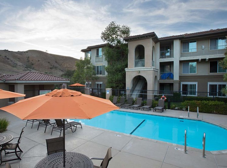 Pool with lounge chairs l Hidden Valley Apartments in Simi Valley Ca