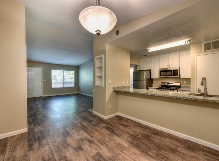 Open kitchen near living room and dining area
