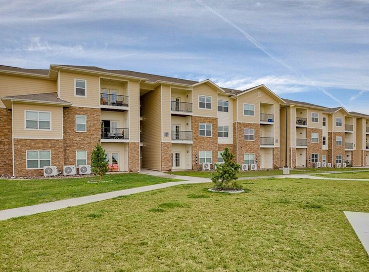Exterior community buildings with grass