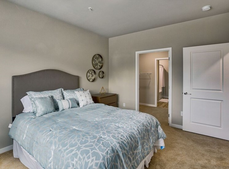 Bedroom with closet and bathroom