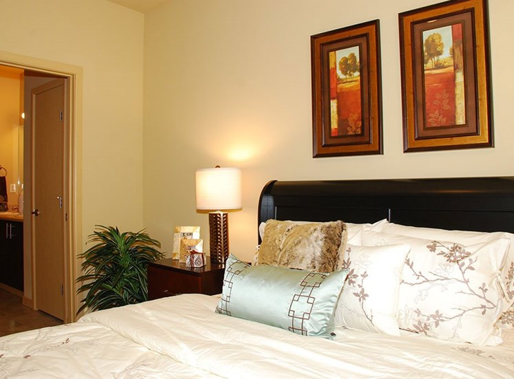 Apartments in Olympia WA - Spacious Bedroom With Beige Walls, Tile Flooring, and Vanity