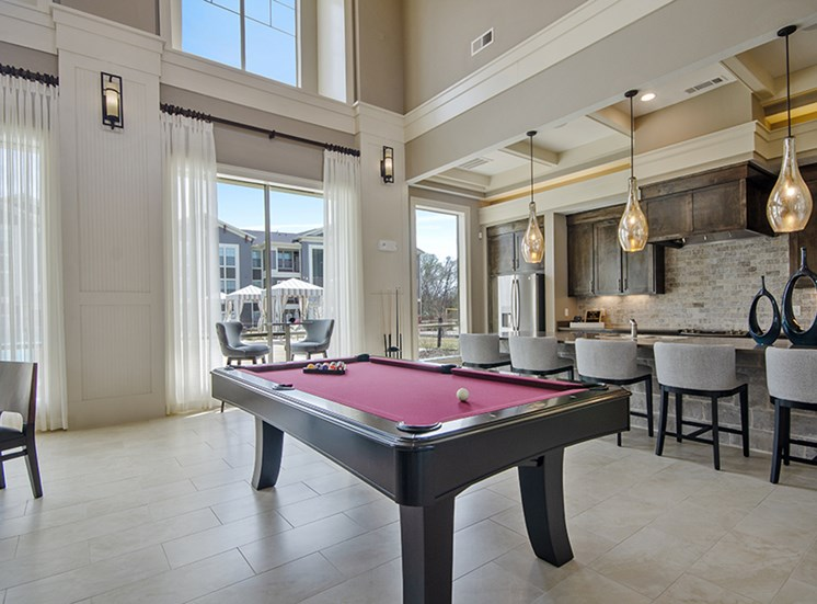 Clubhouse with seating area and pool table