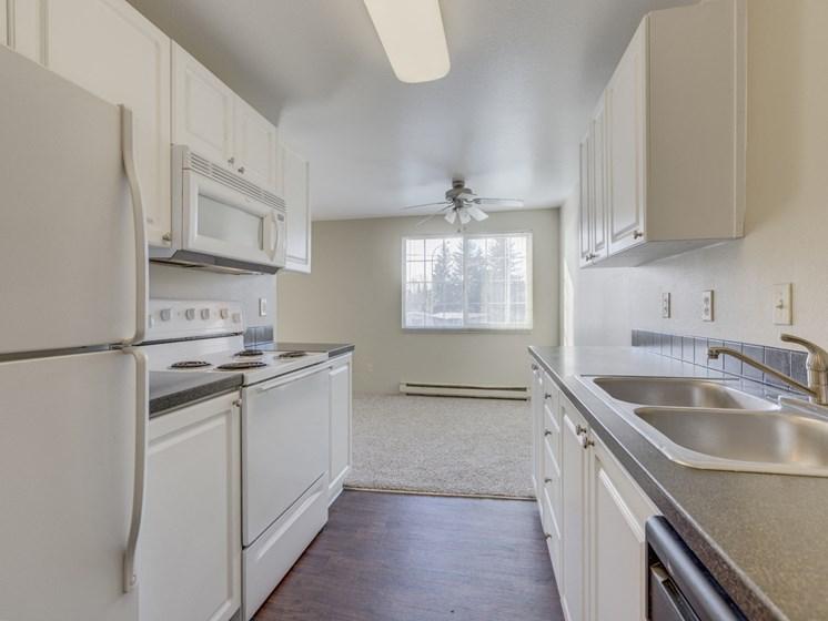 Gourmet Kitchens with Islands, Caesarstone Countertops, and Decorative Backsplash