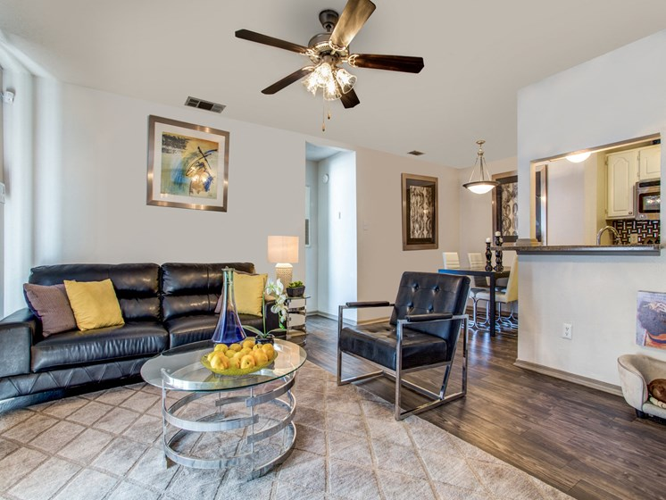 Apartments Austin-The Vibe Apartments Cozy Living Room with Wood Inspired Flooring and Floor to Ceiling Window