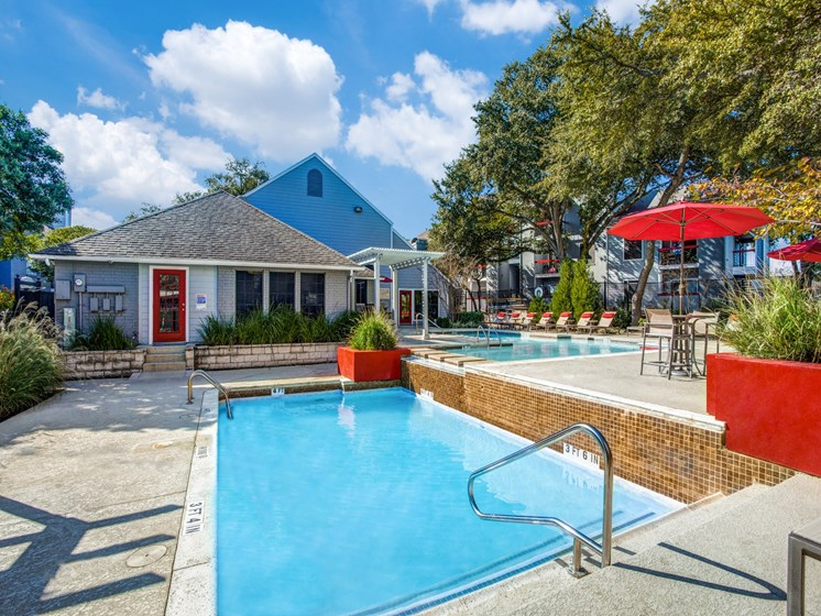 Apartments in Austin TX-The Vibe Apartments Sparkling Pool with Gorgeous Landscape and Lounge Chairs