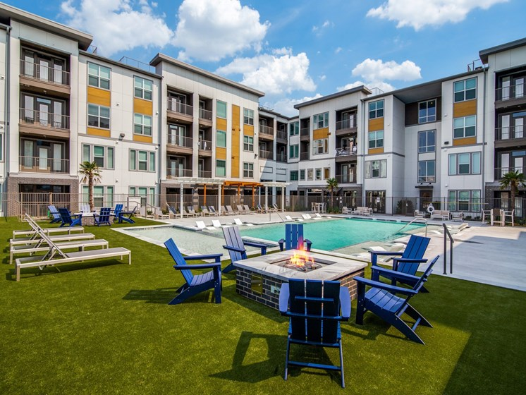 Apartments for Rent Wylie, TX - Seventy8 and Westgate Large Relaxing Pool with Lounge Chairs and Multiple Fire Pits