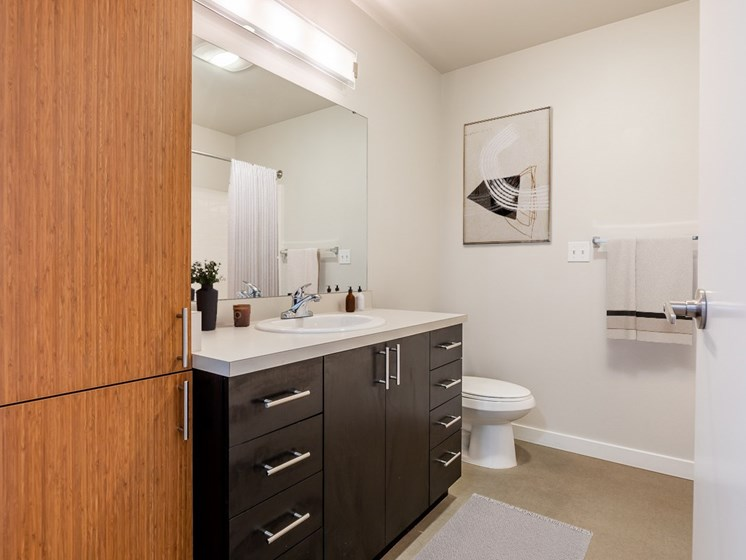 bathroom features washer and dryer in unit