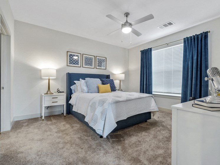 One Bedroom Apartments in Wylie, TX - Seventy8 and Westgate Apartments Bedroom with a Large Window, Large Closet, Ceiling Fan, and Spacious Layouts