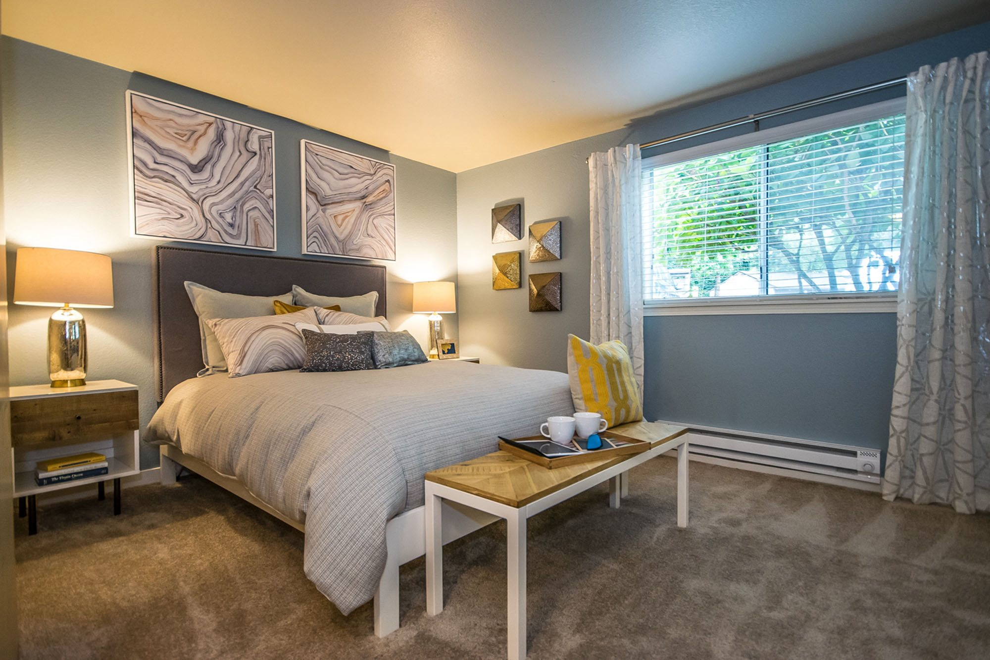 Bedroom with large window at The Fairways Apartments, Tacoma, WA,98422