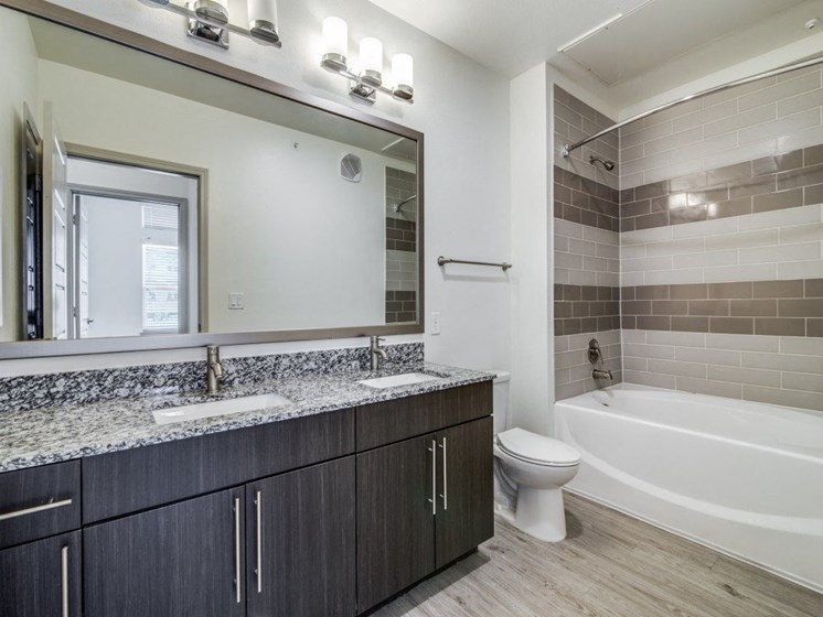 Pet-Friendly Apartments in Rowlett, TX - Harmony Luxury Apartments Bathroom with Vanity and Stainless Steel Fixtures