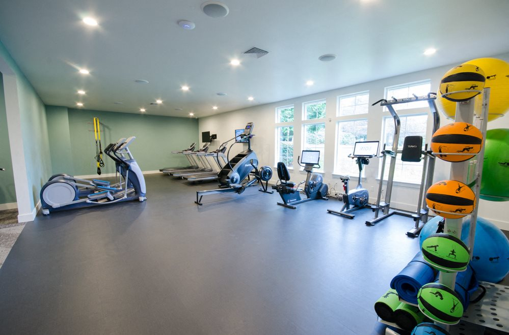 Tacoma Apartments-The Fairways Apartments Fitness Center with Cardio Equipment, Weights, and Yoga Gear