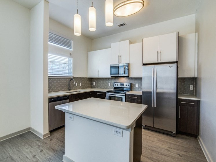 Rowlett, TX Apartments for Rent - Harmony Luxury Apartments Kitchen with Stainless Steel Appliances and Granite Countertops