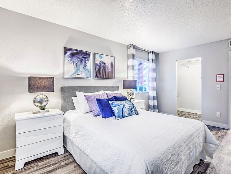 Apartments in Las Vegas Nevada - St. Lucia Bedroom With Wood Inspired Flooring and Modern Decor
