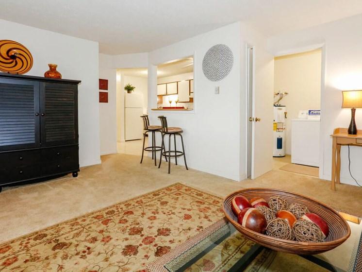 Apartment living room beside open kitchen