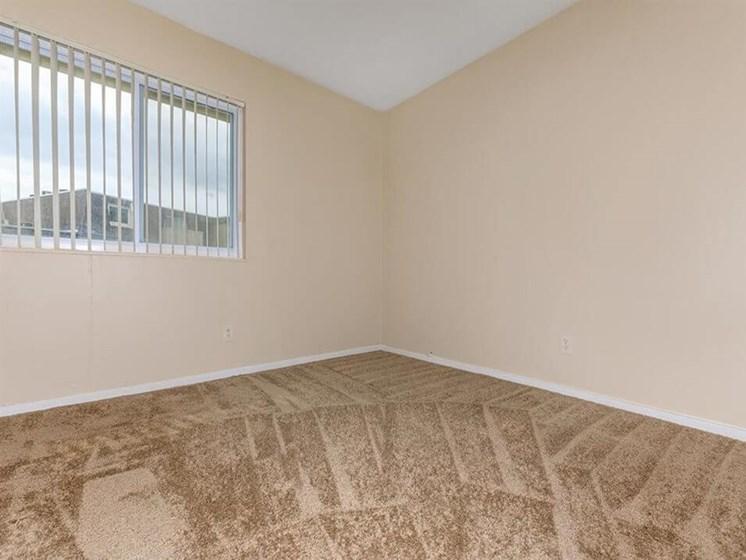 carpeted bedroom at Arbors of Grandview