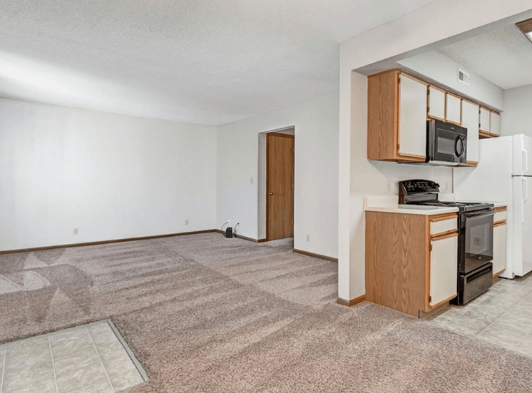 living room and kitchen at apartment complex