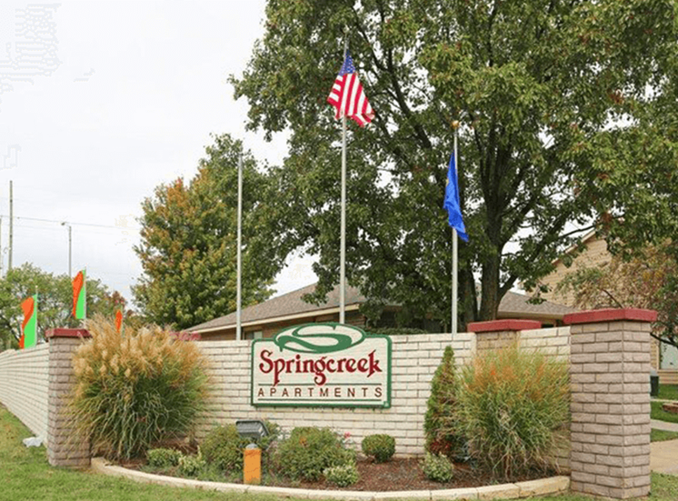 welcome sign for Springcreek Apartments
