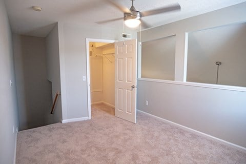 Spacious rooms with overhead ceiling fans and lighting at Deerbrook Apartment Homes in Wilmington, NC 28405