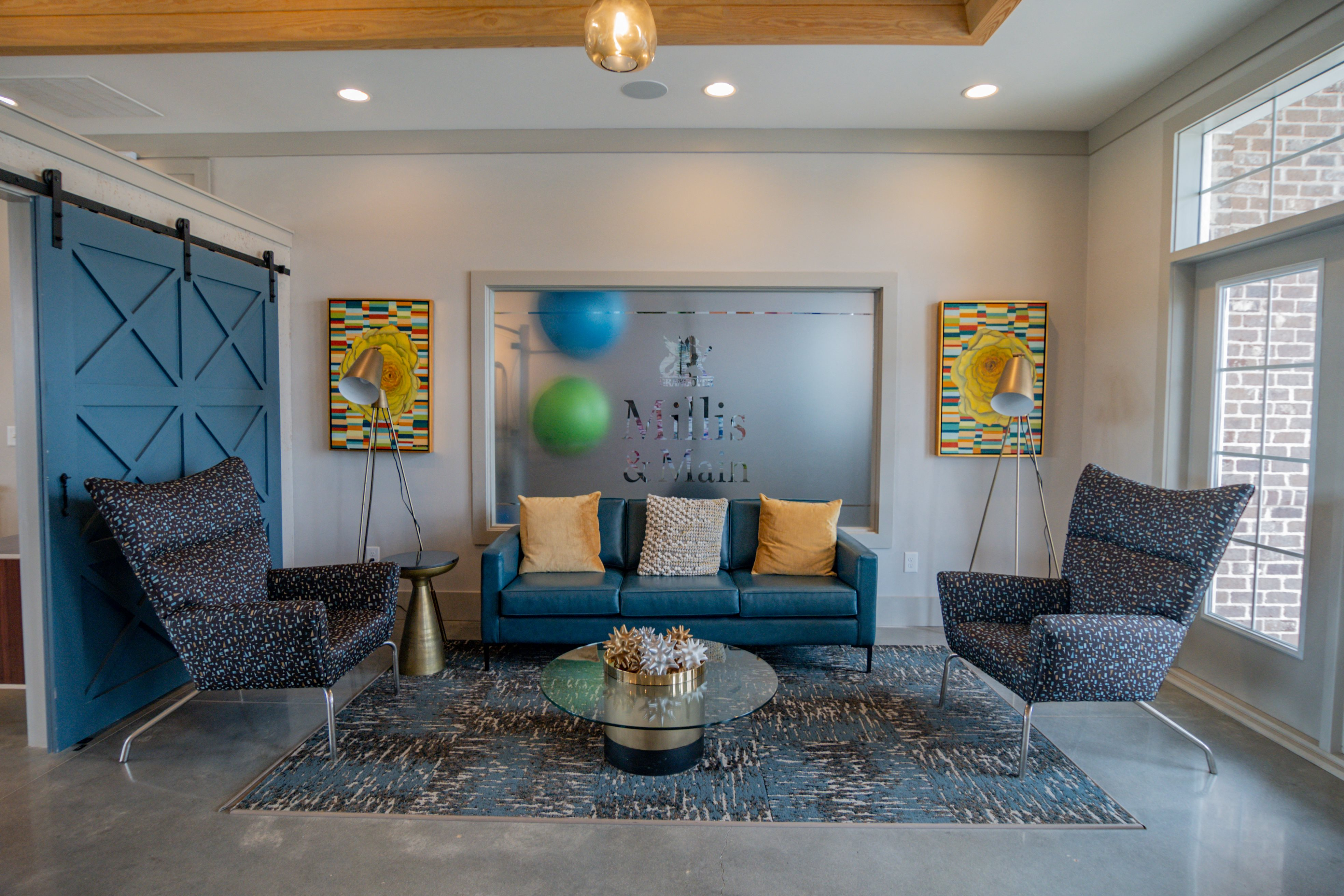Relax with friends and family inside the clubhouse at Millis and Main at Grandover