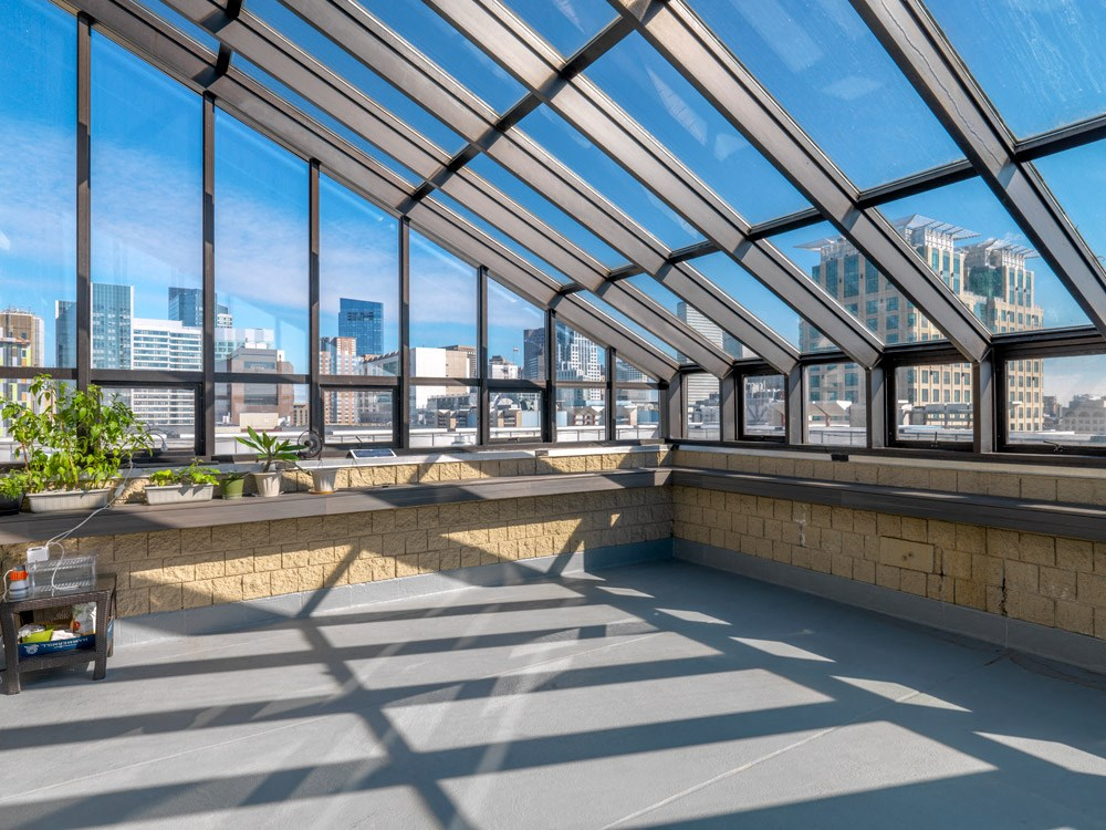 Rooftop solarium and garden at Quincy Tower in Boston, MA